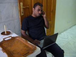 abdin on the phone in sudan