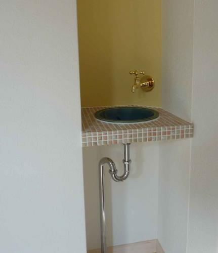 sink with gold faucet