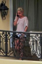 Lady Gaga in see-thru top on a balcony - Nov 25b