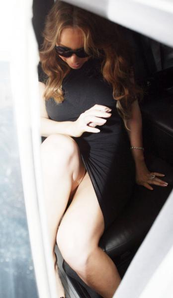 Mariah Carey slight upskirt wearing a little black dress in London